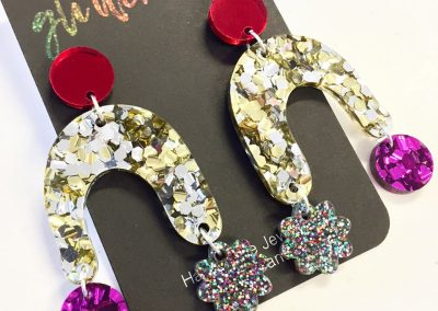 Bambam dangles in chunky gold and silver glitter