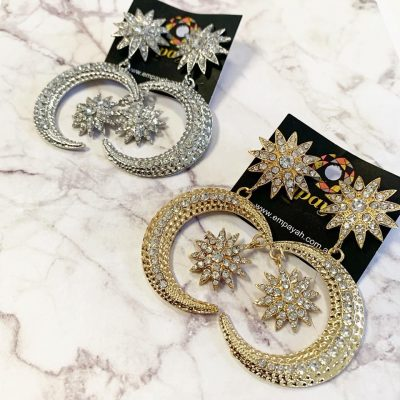 Star and moon rhinestone encrusted gold and silver earring